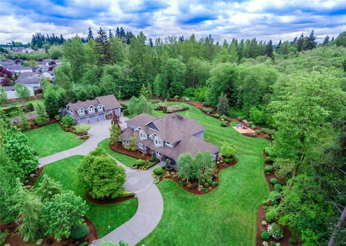 aerial shot of Bothell home on large lot right after roof and gutter cleaning service